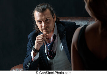 The artist or mature man wearing suit in a classical retro...
