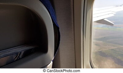 Air passenger PoV in the cabin of plane airline seat and...