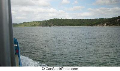 Cruising on the wide open sea - A ship cruises a blue ocean...