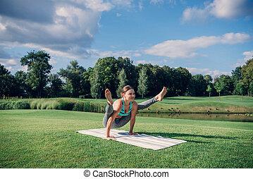 caucasian woman performing yoga pose - fit caucasian woman...