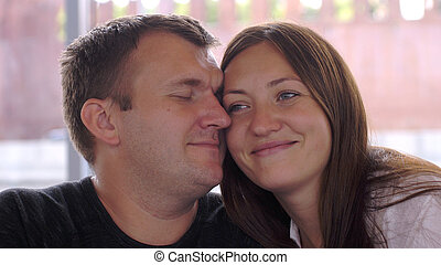 Couple in love cuddling in park - Couple in love cuddling in...