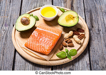 Healthy food vegetables , nuts and salmon . With vitamin...