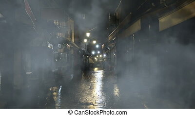 Foggy night on old street