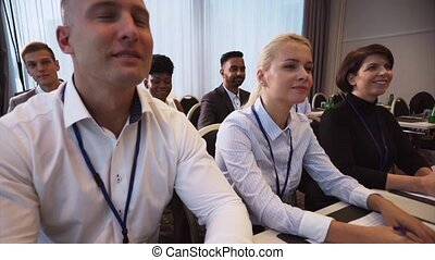 people applauding at business conference - business and...
