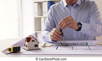 male architect with compass measuring blueprint -...