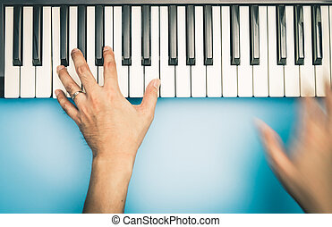 Fast hand Music keyboard player is playing on keyboard top...