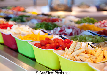 Baby Corn and Fresh Vegetables on Salad Bar - Fresh cut...