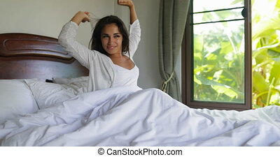 Young Woman Waking Up In Bed Stretching Arms, Beautiful Girl...