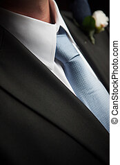 Blue Tie Knot On a Groom. - Close up of a blue tie knot on a...