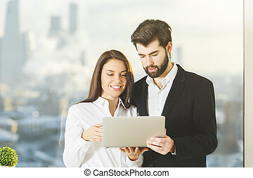 Smiling people using laptop - Smiling businessman and woman...