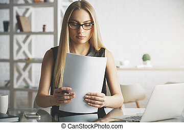 Caucasian woman doing paperwork - Portrait of young...