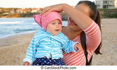 Mather and baby - Beautiful brunette mom with her...