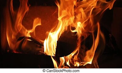 Flames of a fireplace - Burning fire, slow motion from 120...