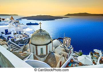Fira, Santorini, with white village, cobbled paths, greek...