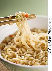 Noodles - Chinese noodles on chopsticks close up shoot