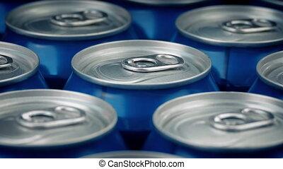 Beer Cans Closeup - Many beer cans rotating macro shot