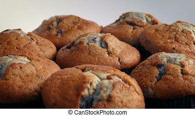 Delicious Blueberry Muffins Rotating - Plate of blueberry...