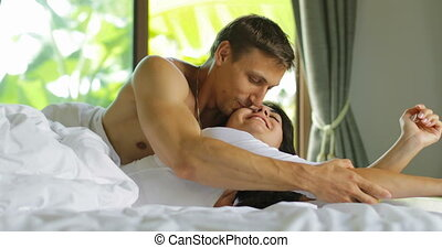 Couple In Bed Kissing Waking Up, Lovers Bedroom Happy Young...