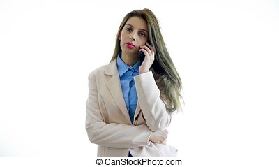 Young businesswoman over white background talking on the...