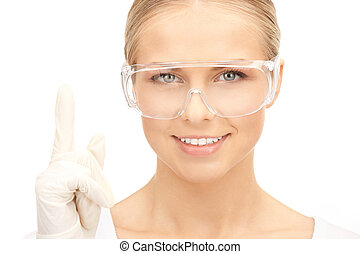 woman in protective glasses and gloves - bright picture of...