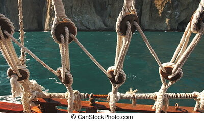View Through Ropes of Ship at Sea