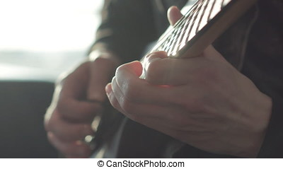 Man Playing on an Electric Guitar - Extreme close up of...