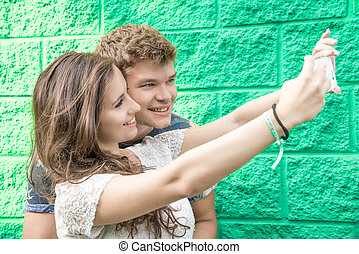 couple has fun with smartphone