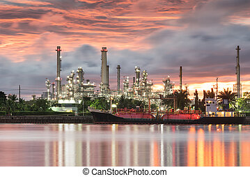 oil and gas refinery petrochemical factory at sunset