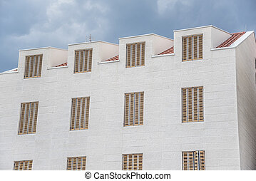 White building with beautiful windows. Wall with windows.