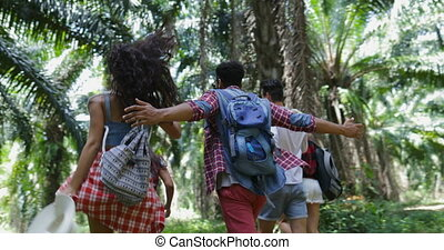 Cheerful People Group With Backpacks Trekking In Forest,...