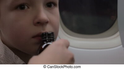 Child in plane refusing to take medicine