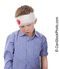 Crying boy with a bandaged head