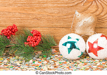 Christmas-tree decorations. Located on a wooden background.