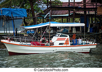 motor boat at the pier in Tai ,the concept of fishing and...