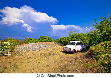 Old fashion car wreck in nature in Skrip vilage on Brac...