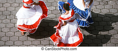 Mexican dancers. - Mexican dancers performing in concert.