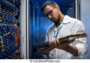 Scientist Inspecting Supercomputer Servers - Portrait of...
