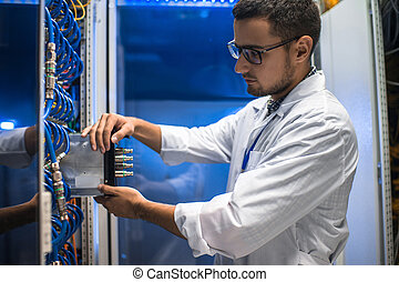 Scientist Working with Supercomputer - Side view portrait of...