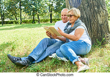 Loving Senior Couple at Park - Full length portrait of...