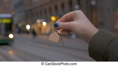 Keys of your own apartments - Close-up shot of a woman...