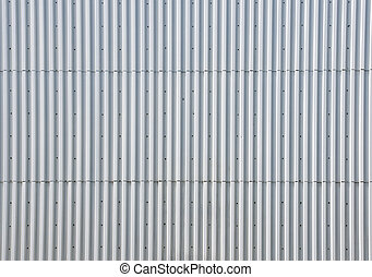 Metal facade of a building - A silver metal facade of a...