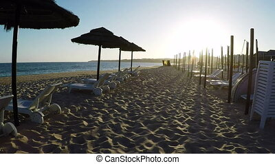 Sunset on southern beach of Portugal Albufeira, Algarve. -...