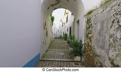 Passage through the arch in the old town of Albufeira.....