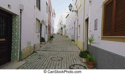 Historical streets with paving stones of the ancient city of...