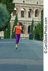 young healthy woman in sportswear in Rome, Italy running -...