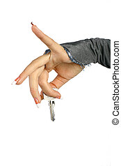 key - The woman hand gives the key on a white background