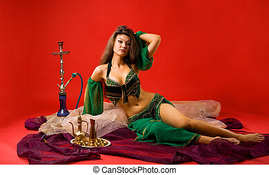 beauty young woman with hookah on veil in red
