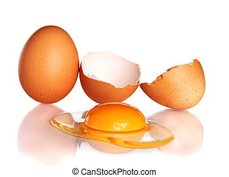 Egg and smashed an egg on a white background - Hens egg and...
