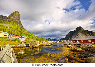 Scenic village of Reine - Fishing huts, rorbu in Reine,...