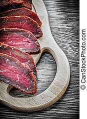 Carved steak wooden carving board food concept.